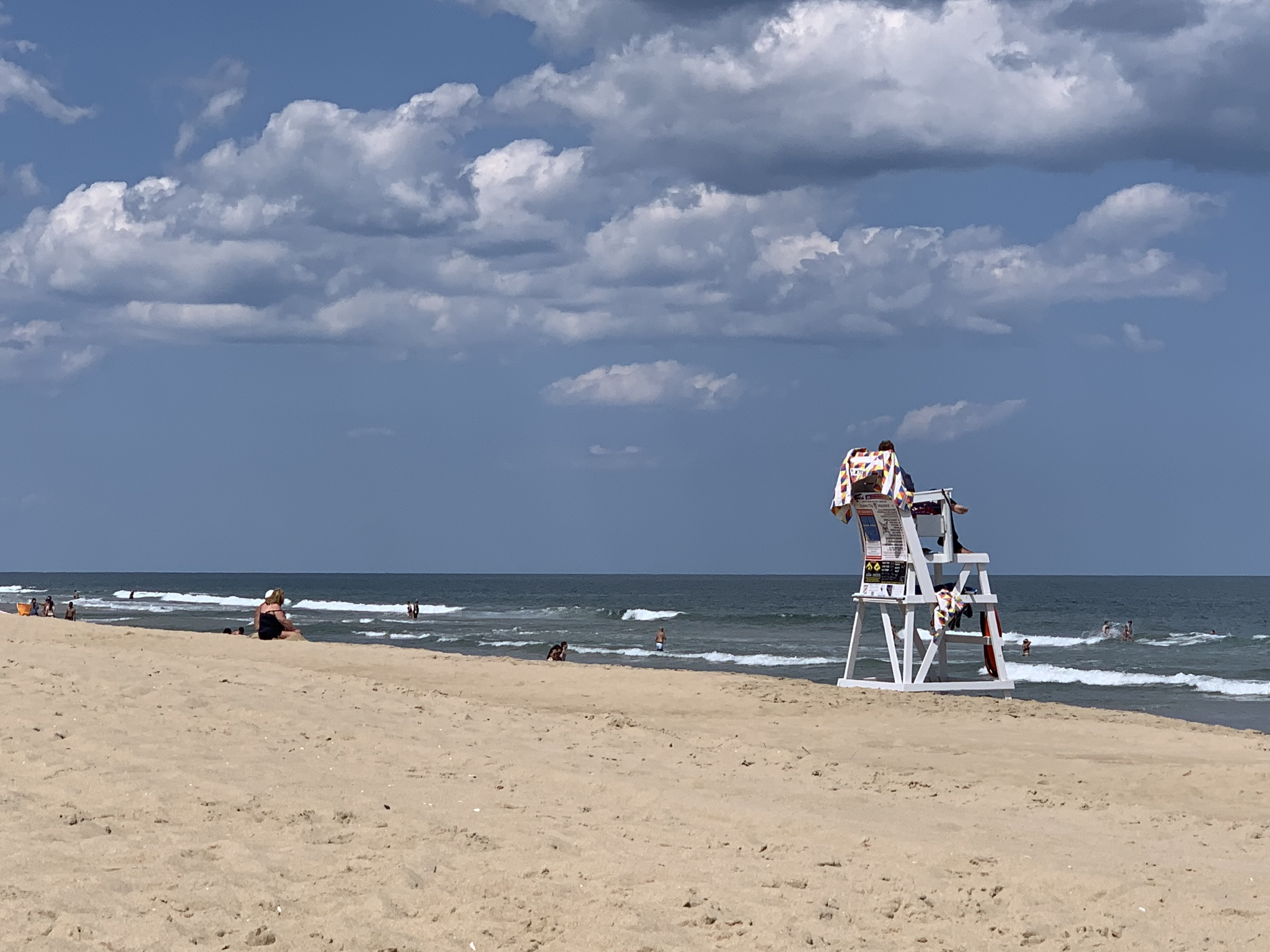 A day at the beach, but the clouds may get in the way and impact your day. Ocean City, Maryland.